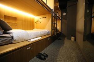 A bed or beds in a room at Philstay Myeongdong Boutique Female