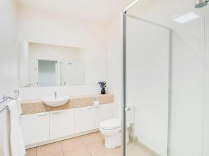 A bathroom at McKillop Geelong by Gold Star Stays