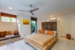 A bed or beds in a room at Ganesh Lodge