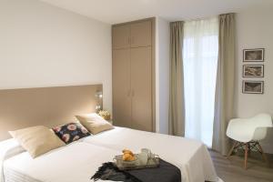 Cama o camas de una habitación en Apartamentos Campo Del Príncipe