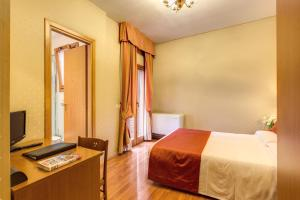 A bed or beds in a room at Flower Garden Hotel