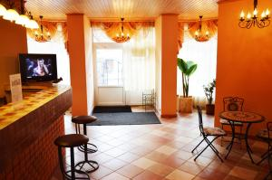 A seating area at Agio Hotel