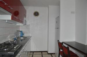 A kitchen or kitchenette at Apartment On Pribuzhskaya 2
