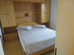A bed or beds in a room at Apto 504 no Solar das Hortênsias