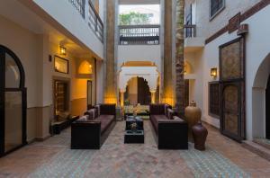 The lobby or reception area at Riad 5 Sens