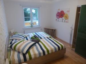 Ein Bett oder Betten in einem Zimmer der Unterkunft Haus am Fluss