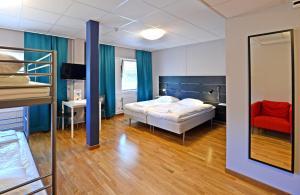 Säng eller sängar i ett rum på Spoton Hostel & Sportsbar