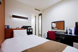 Tempat tidur dalam kamar di Kagoshima Plaza Hotel Tenmonkan