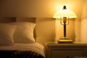 Łóżko lub łóżka w pokoju w obiekcie Polski Dom Rodziny Serce