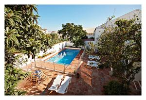 A view of the pool at Hostal La Posada or nearby