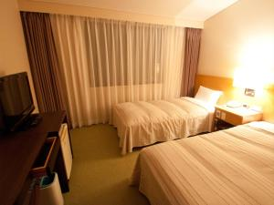 A bed or beds in a room at Hotel Folkloro Hanamakitowa
