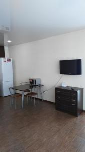 A television and/or entertainment center at Apartment Irkutsk