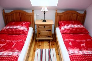 Łóżko lub łóżka w pokoju w obiekcie Storczykowe Wzgórze