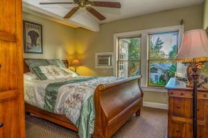A bed or beds in a room at The Historic Peninsula Inn
