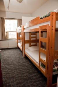 A bunk bed or bunk beds in a room at HI Vancouver Central