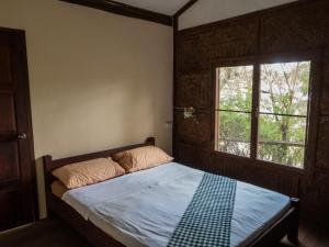 A bed or beds in a room at Sala Thongyon