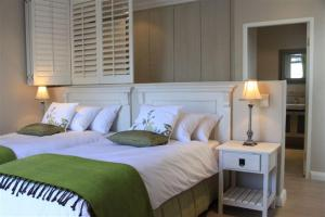 A bed or beds in a room at Spatalla Holiday Homes