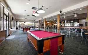 A pool table at Nightcap at Playford Tavern