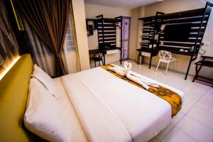 A bed or beds in a room at Louis Hotel