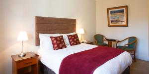 A bed or beds in a room at The Clonakilty Hotel