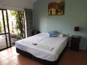 Un ou plusieurs lits dans un hébergement de l'établissement Aremango Guesthouse