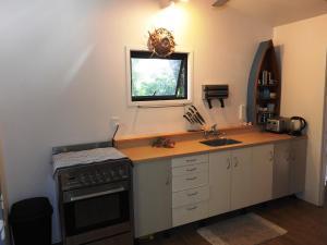 Cuisine ou kitchenette dans l'établissement Aremango Guesthouse