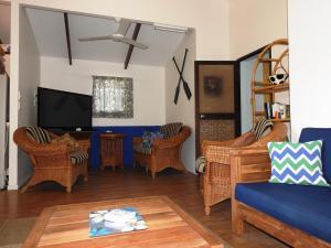 Coin salon dans l'établissement Aremango Guesthouse