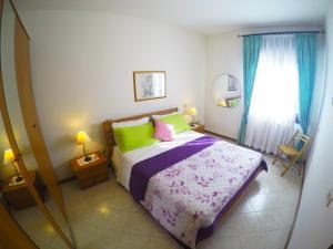 Postel nebo postele na pokoji v ubytování Appartamenti Ponente