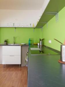 A kitchen or kitchenette at PM-Rooms