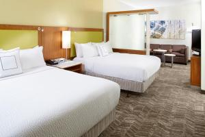 A bed or beds in a room at SpringHill Suites Houston Intercontinental Airport
