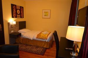 Un ou plusieurs lits dans un hébergement de l'établissement Beausite