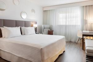 A bed or beds in a room at AC Hotel by Marriott Paris Le Bourget Airport