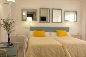A bed or beds in a room at Ares Hotel