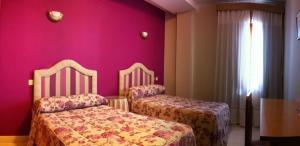 Cama o camas de una habitación en El Torreon del Miguelete