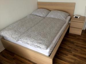 Ein Bett oder Betten in einem Zimmer der Unterkunft Apartment Westside