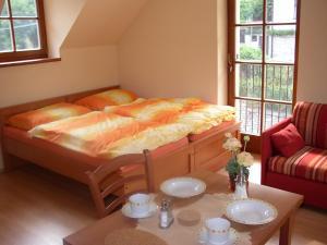 Postel nebo postele na pokoji v ubytování Pension a Restaurace Vyhlídka