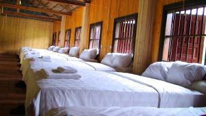 Un ou plusieurs lits dans un hébergement de l'établissement Whisper Nature Bungalow & Resort