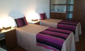 Una cama o camas en una habitación de Tramas Andinas