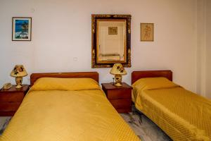 A bed or beds in a room at Odysseus Palace