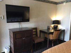 A television and/or entertainment center at Days Inn by Wyndham Fresno Central
