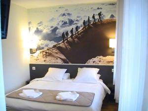 Un ou plusieurs lits dans un hébergement de l'établissement Hôtel La Grande Cordée