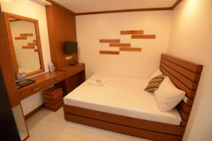 A bed or beds in a room at Abozza Resort
