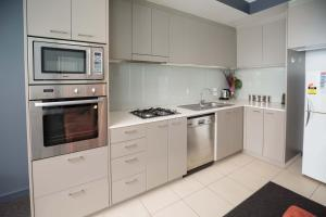 A kitchen or kitchenette at Honeysuckle Executive Suites