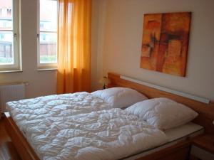 Ein Bett oder Betten in einem Zimmer der Unterkunft Residenz Leuchtturm L15