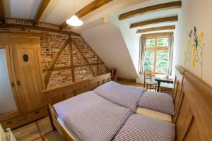 Ein Bett oder Betten in einem Zimmer der Unterkunft Landhaus Schulze Osthoff