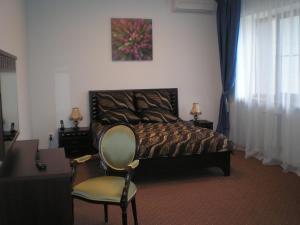 Кровать или кровати в номере Санаторно-Курортный Комплекс «Эльтон»