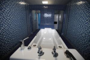 Ванная комната в Санаторно-Курортный Комплекс «Эльтон»