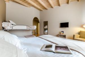 Cama o camas de una habitación en Hotel Nagusi