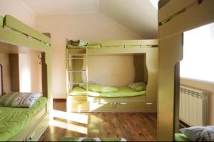 A bunk bed or bunk beds in a room at Almaty Backpackers
