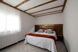 Una cama o camas en una habitación de Apartments Mo